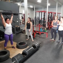 Coach Kayla teaching the finer points of logpress in her strongwoman group tonight.  Awesome job girls. #strongmanisforeveryone #adrenalinefamily #strongwoman #strength #logpress