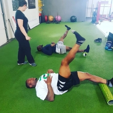 Coach @wwfitness_deanna_wells working on some hip mobility with @sskroughriders Sam Eguavoen #47 and Jovon Johnson #2 during one of their recovery workouts. . . . #adrenalinestrengthandconditioning #riders #cfl #football #riderpride #athletetraining #stre